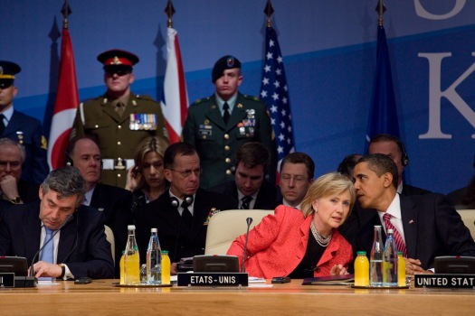 Obama and Clinton speaking with one another at the 21st NATO summit, April 2009