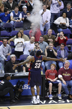 James engages in his pre-game ritual of tossing crushed chalk into the air in March 2008. The routine was retired from 2011 to 2014.[4][4]
