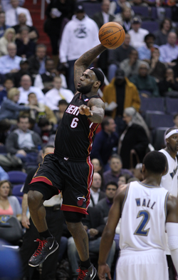 James attempts a slam dunk in March 2011 as a member of the Miami Heat.