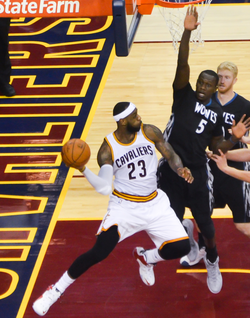 James throws a pass in December 2014. Later that season, he reached several passing milestones, including becoming the Cavaliers' all-time assists leader.[2][2]