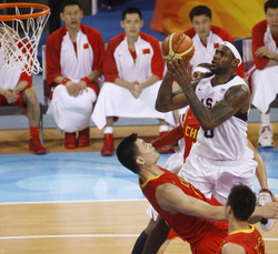 James attempts a shot over China's Yao Ming at the 2008 Summer Olympics in Beijing.