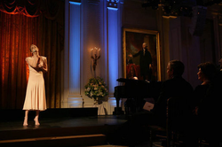 President George W. Bush and Laura Bush listen to LeAnn Rimes perform in the East Room of the White House in a performance honoring the Dance Theatre of Harlem on February 6, 2006