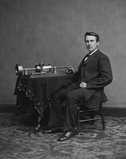 Photograph of Edison with his phonograph (2nd model), taken in                                 Mathew Brady                                's Washington, DC studio in April 1878.