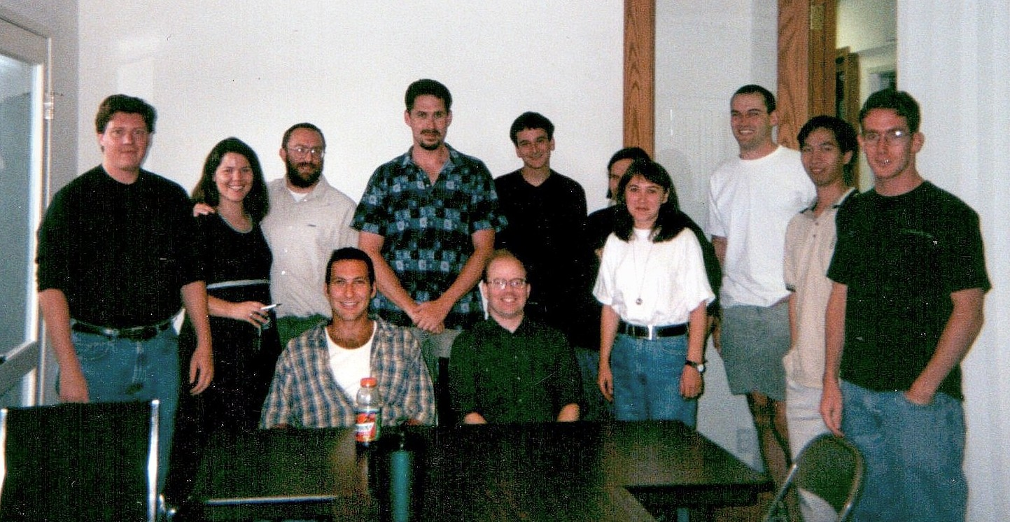 The staff of Wales's Internet company Bomis photographed in summer 2000. Wales is third from the left in the back row, with his then-wife Christine.