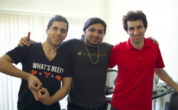 Travis pictured at Everipedia HQ with founder Sam Kazemian and co-founder Mahbod Moghadam