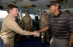 Woods visiting aircraft carrier USS George Washington (CVN-73) in the Persian Gulf before participating in the 2004 Dubai Desert Classic