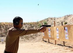 Woods shoots a handgun during training at a shooting range outside San Diego.