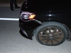 Woods's front tire on his 2015 Mercedes-Benz S65 AMG during his DUI arrest