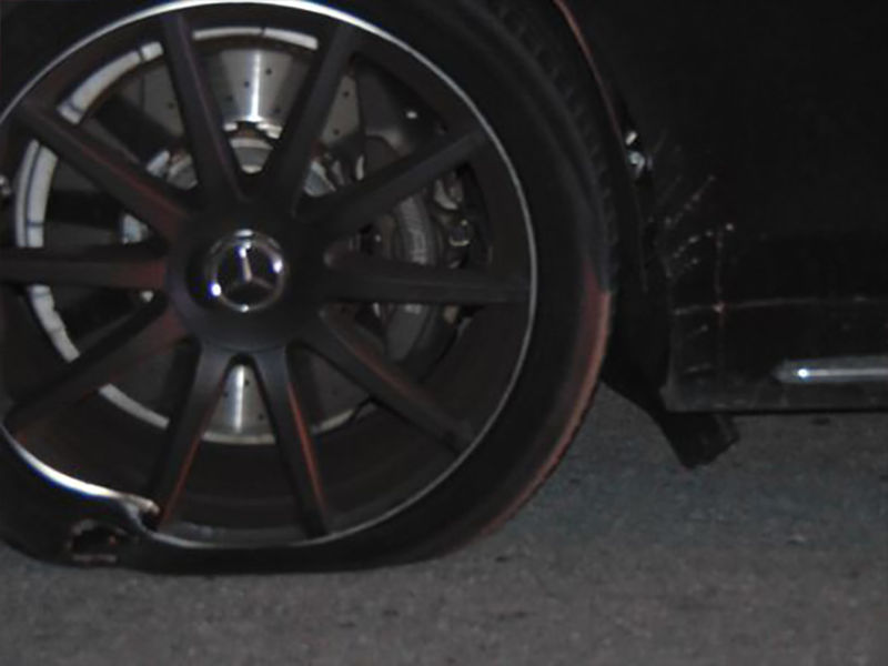 Photo of a bent rim and torn tire on Woods2015Mercedes-Benz S65 AMG