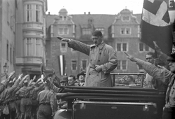 Adolf Hitler                                at a German                                 National Socialist                                political rally in                                 Weimar                                , October 1930