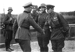 German and Soviet army officers pictured shaking hands—after Nazi Germany and Soviet Union annexed new territories in Eastern Europe, 1939