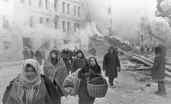 Soviet civilians in                                 Leningrad                                leaving destroyed houses, after a German bombardment of the city;                                 Battle of Leningrad                                , 10 December 1942