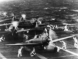 "Mitsubishi A6M2                                ""Zero"" fighters on the                                 Imperial Japanese Navy                                aircraft carrier                                 Shōkaku                                , just before the attack on                                 Pearl Harbor"