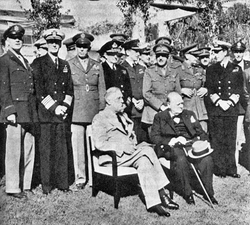 Seated at the                                 Casablanca Conference                                ; US President                                 Franklin D. Roosevelt                                and British PM                                 Winston Churchill                                , January 1943
