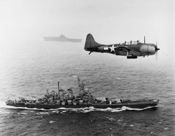 US Navy                                 Douglas SBD Dauntless                                flies patrol over the                                 USS Washington                                and                                 USS Lexington                                during the Gilbert and Marshall Islands campaign, 1943