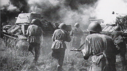 Red Army troops following T-34 tanks, in a counter-offensive on German positions, at the Battle of Kursk, August 1943