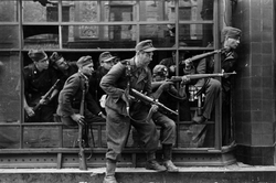 German                                 SS                                soldiers from the                                 Dirlewanger Brigade                                , tasked with suppressing the                                 Warsaw Uprising                                against Nazi occupation, August 1944