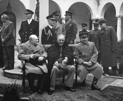 Yalta Conference                                held in February 1945, with                                 Winston Churchill                                ,                                 Franklin D. Roosevelt                                and                                 Joseph Stalin
