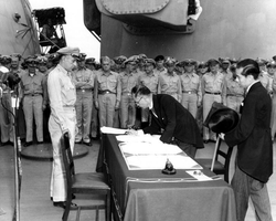 Japanese foreign affairs minister Mamoru Shigemitsu signs the Japanese Instrument of Surrender on board the USS Missouri, 2 September 1945