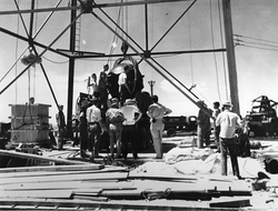 Nuclear Gadget being raised to the top of the detonation tower, at Alamogordo Bombing Range; Trinity nuclear test, July 1945