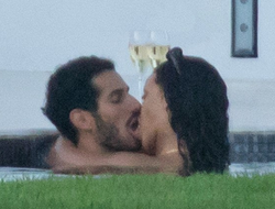 Kissing her boyfriend Hassan Jameel​.