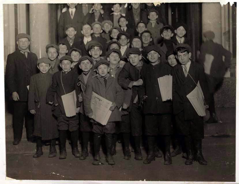 Newsboys for the Forward wait for their copies in the early morning hours in March 1913
