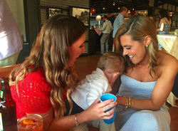 Photo of Lisa Boothe with a friend and her child
