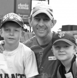 Black and white photo of Peter Werner with his two sons.