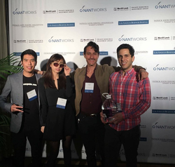 With members of the                               Everipedia                              founding team during an awards ceremony in                               Beverly Hills, California