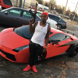 Blac Youngsta next to a Lambo