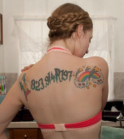 Ela Darling's tattoos on her back include the state of Texas, the Dewey Decimal and Cutter number for                               Harry Potter and the Philosopher's Stone                              , and a collection of stars and hearts surrounding a rainbow