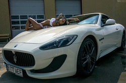 Photo of                               Roxana Vancea                              modeling on top of a                               Maserati                              ​.