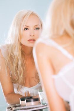 Photo of Shera Bechard facing a mirror from a Playboy photo shoot                                                                  [10]                                                               