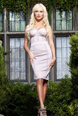 Shera Bechard wearing a dress[11]