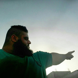 Sajad Gharibi pointing at the sky