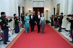 Governor and Mrs. Clinton attend the Dinner Honoring the Nation's Governors in the                                 White House                                with President                                 Ronald Reagan                                and first lady                                 Nancy Reagan                                , 1987.