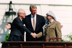 Clinton,                                 Yitzhak Rabin                                and                                 Yasser Arafat                                during the Oslo Accords on September 13, 1993.