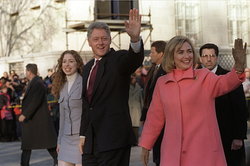 President Bill Clinton (center), first lady Hillary Rodham Clinton (right) and their daughter                                 Chelsea                                (left) wave to watchers at a parade down Pennsylvania Avenue on Inauguration Day, January 20, 1997.