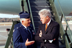Clinton speaks with                                 Col.                                                 Paul Fletcher                                ,                                 USAF                                , before boarding                                 Air Force One                                , November 4, 1999.