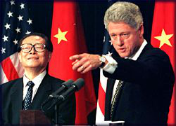 Clinton and                                 Jiang Zemin                                holding a joint press conference at the White House, October 29, 1997