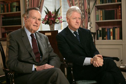 Clinton with former President George H. W. Bush in January 2005