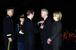 Secretary of Defense                                                 Cohen                                presents President Clinton the DoD Medal for Distinguished Public Service.