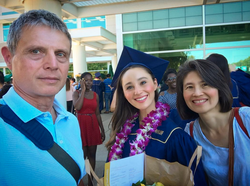 Gabi with her parents Carl and Emerald Holzwarth at her UC Davis graduation ceremony in 2017.