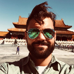 Photo of Alex Tapscott that was taken while at the Forbidden City in Beijing .