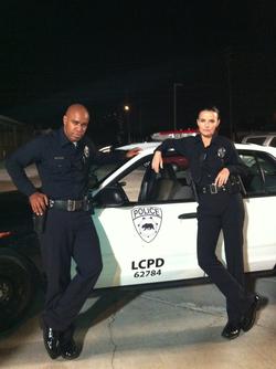 Ana Alexander in a cop uniform