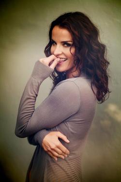 Ana Alexander smiling biting her finger