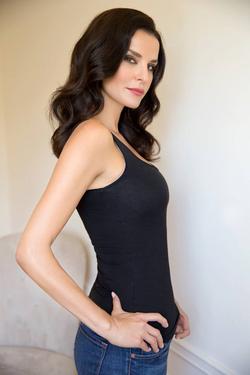 Ana Alexander (black top, blue jeans)