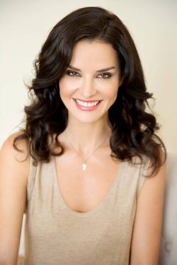Ana Alexander smiling (cream top)