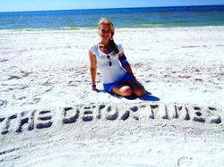Andrea on Clearwater Beach after a long day creating the company logo The Detox Times.