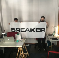 Photo of Breaker Magazine editors with a Banner.